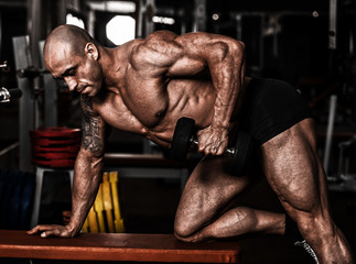 very power athletic guy bodybuilder , execute exercise with dumb