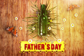 beer bottle in front of wooden floor for father's day