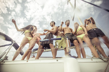 group of friends making party on the boat