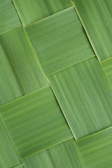 Close-up diagonal pattern of woven grass leaves
