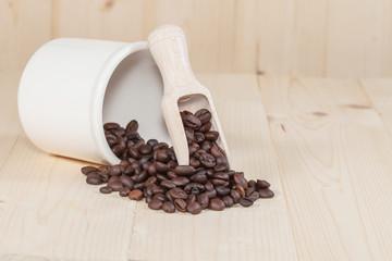 Fresh coffee bean and wood spoon