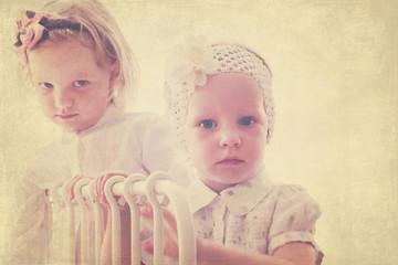 Portrait of beautiful little girls (sisters)  in vintage style.