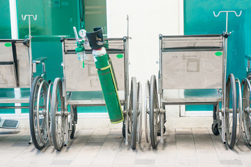 Wheelchair and oxygen tank in the  hospital
