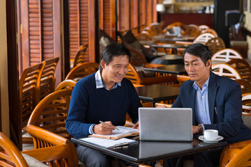 Business meeting in coffee shop
