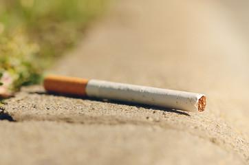 Cigarette on asphalt