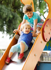 baby girls  on slide at playground