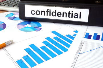 Folder with the label confidential and charts