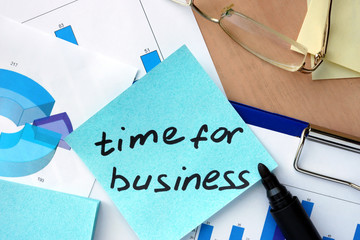 Paper with words time for business and charts.