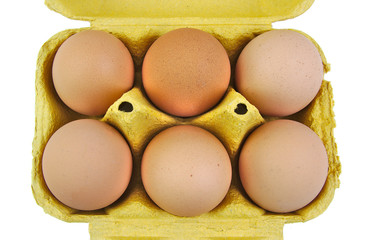 Half a dozen eggs in a yellow carton viewed from the front