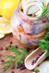 Marinated herring in a jar