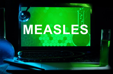 Computer with word Measles .