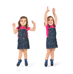 Kid jumping over isolated white background