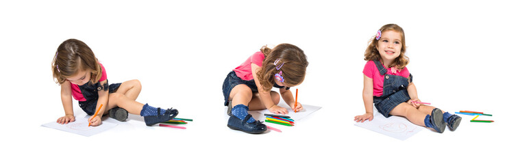 Kid drawing crayons over white background