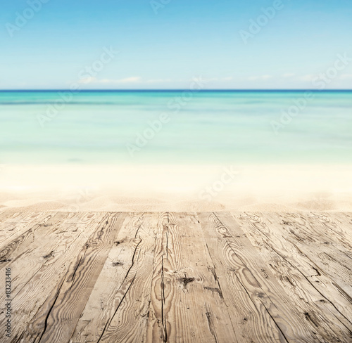 Fotobehang Lichtblauw Empty wooden pier with view on sandy beach