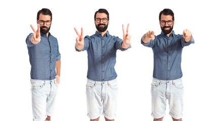 Young hipster man doing victory gesture