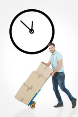 Composite image of happy delivery man pushing trolley of boxes