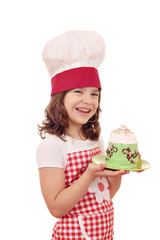 happy little girl cook with big cupcake