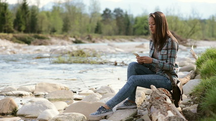 Girl texting with her mobile phone and relaxing