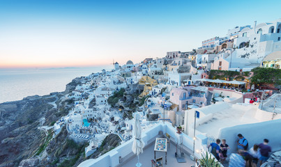 SANTORINI - JULY 11, 2014: People wait for sunset time in Oia to