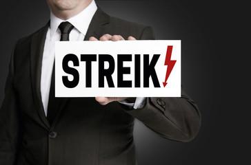 Streik schild wird von Geschäftsmann  gehalten