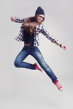 Dancing hipster girl in glasses and black beanie
