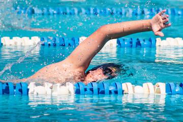Man swimming in an Olympic pool