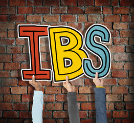 Group of Hands Holding IBS Letter