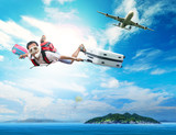 young man flying on blue sky wearing snorkeling mask and holding