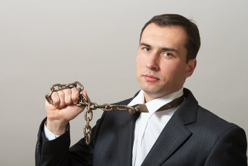 Businessman with neck chain looking at camera