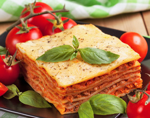Tasty flavorful lasagna on a plate and ingredients