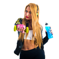 Sport woman holding energy drink and doing weightlifting
