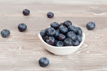 white bowl of fresh blueberries closeup
