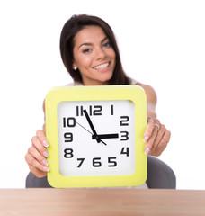 Happy businesswoman showing big clock