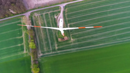 Flying over wind turbine producing renewable energy