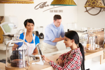 Ordering or paying by digital tablet in a cafe