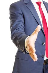 Businessman extending hand for handshake