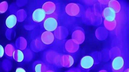 Blinking bokeh lights on blue background