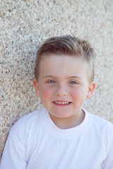 Smiling boy with blue eyes looking at camera