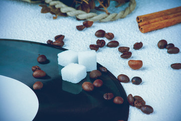 Sugar cubes and coffee beans on a vinyl plate