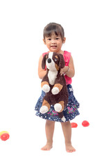 cute asian baby girl with dog doll