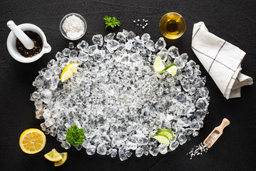 Food ingredients  and crushed ice on black table