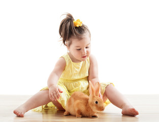 little girl with rabbit isolated on white