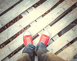 young man feet in red sneakers