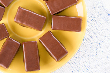 Chocolates on a yellow plate