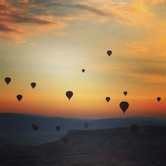 balloons over sunrise in cappadocia