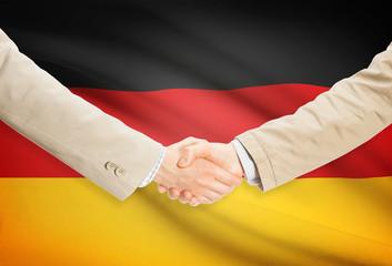 Businessmen handshake with flag on background - Germany