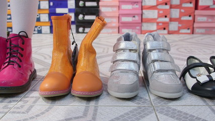 Dolly: Row of new shoes for girls in the children shoe store