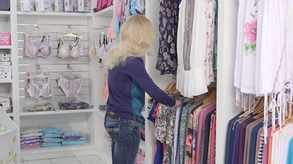 Clothes shopping in baby and maternity shop