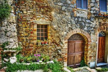 brick wall and wooden doors