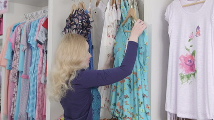 Clothes shopping  for summer dress in clothing store